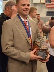 Nick Donner with the Kinsinger trophy after winning