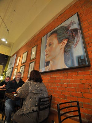 Customers enjoy their coffees Friday afternoon at Allister Deacon's Coffee House in downtown Wausau.