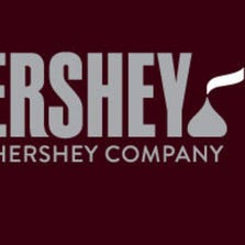 It now features an updated version of a Hershey Kiss Chocolate at the end of the company name.