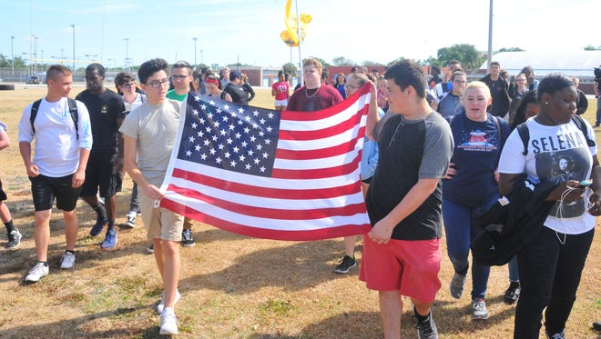 About 75 students walked out of Rockledge High School in Florida at 10:30 a.m. on Friday and onto the athletic field in support of the 2nd Amendment.