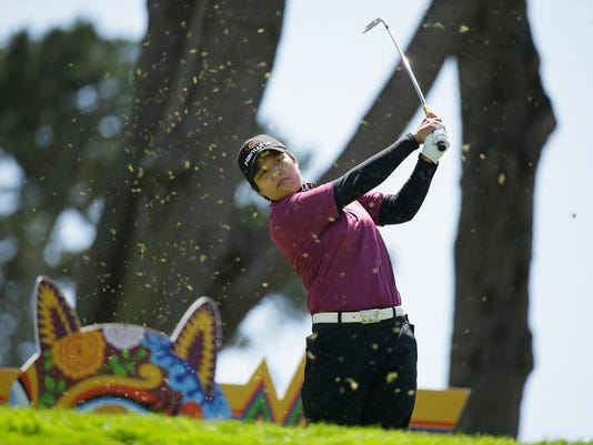Haru Nomura, of Japan, follows her shot from the third tee of the Lake Merced Golf Club during the second round of the Swinging Skirts LPGA Classic golf tournament Friday, April 22, 2016, in Daly City, Calif. (AP Photo/Eric Risberg)