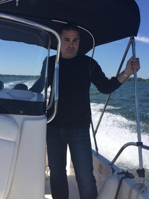 Anthony Fratianne, who attended and played baseball at the Coast Guard Academy after graduating from Cincinnati Country Day, on his boat.