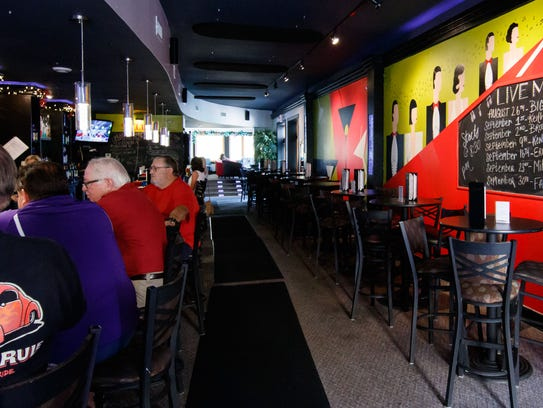 People sit at the bar at Splash Martini Bar in Oconomowoc.