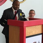 Reggie Choplin, left, addresses a gathering at Wade Hampton after being introduced Thursday as the school's athletic director and boys basketball coach, replacing Darryl Nance, right.