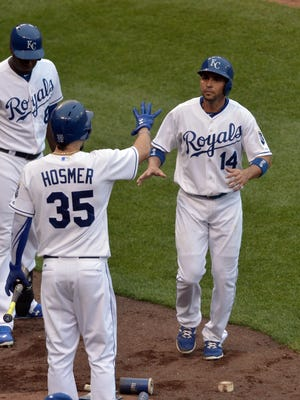 Kansas City Royals second baseman Omar Infante, right, is congratulated by first baseman Eric Hosmer (35) after scoring against the New York Yankees at Kauffman Stadium.