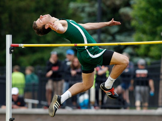 Williamston's Sy Barnett competes in the high jump during the Division 2 MHSAA track finals, Saturday, June 3, 2017, in Zeeland, Mich.