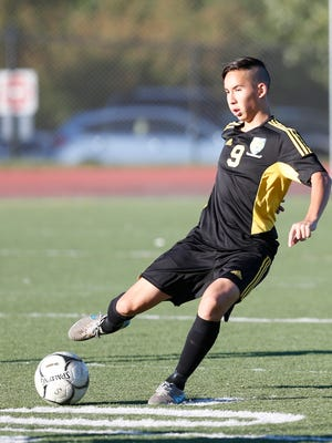 Hasting's Oscar Pereira (9) feeds a pass during a boys varsity soccer game against  Blind Brook in Rye Brook on Tuesday, October 11, 2016.