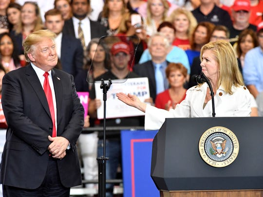 U.S. Senate candidate Marsha Blackburn gestures toward President Donald Trump at a rally at Municipal Auditorium  Tuesday May 29, 2018, in Nashville, Tenn.