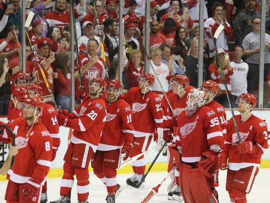 The Red Wings salute the fans after the 4-1 win over
