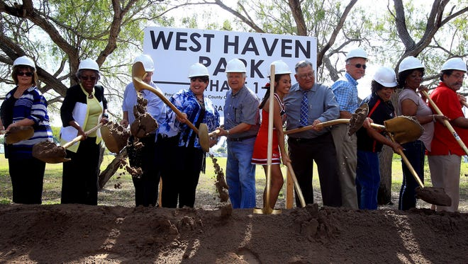 City of Corpus Christi Parks & Recreation Department and West Oso Independent School District officials toss dirt during the Westhaven Park groundbreaking Sept. 1, 2016.
