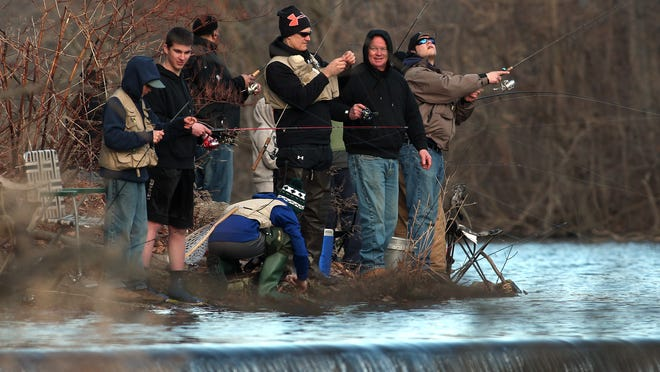 Fishermen at Speedwell Lake in Morristown cast their lines on the opening day of NJ trout season. April 4, 2015. Morristown, N.J. Bob Karp/Staff Photographer.