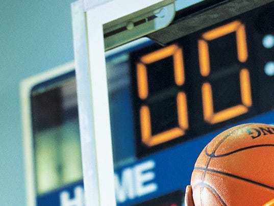 Basketball player scoring as time expires