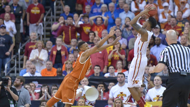 Iowa State Cyclones guard Monte Morris (11) shoots the winning basket at the buzzer as Texas Longhorns Demarcus Holland (2) defends during the quarterfinals at Sprint Center.