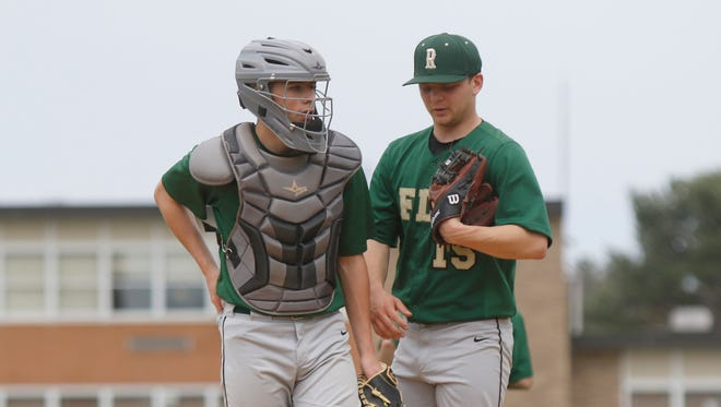 FDR catcher Michael Santoro (5) left, and pitcher Pitcher Oakley (15) talk on the mound in-between batters during varsity baseball action against North Rockland at FDR High School in Hyde Park on Saturday, April 15, 2017.  North Rockland won 7-2.