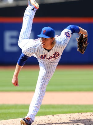 Mets starting pitcher Noah Syndergaard pitches during the eighth inning at Citi Field.