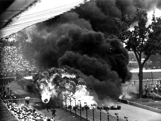 One of the most stunning photographs in Indianapolis 500 history: A burning tire (bottom left) flies toward spectators in the early parts of the 1964 race. Two drivers, Dave MacDonald and Eddie Sachs, were killed.