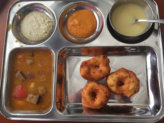 Fritters made from urad dal, or black gram beans, are