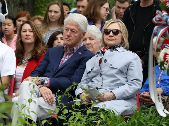 Bill and Hillary Clinton attend the Memorial Plaza ceremony after the Town of New Castle Memorial Day Parade May 28, 2018 in Chappaqua.