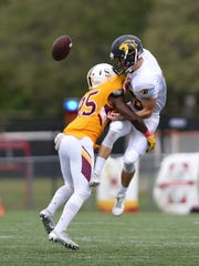 Salisbury's Christian Wilson breaks up a pass to The