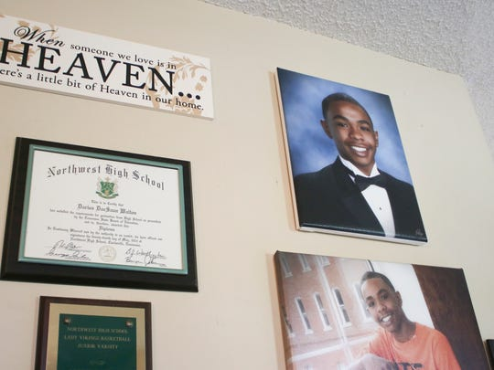 Darius Walton's diploma and senior portraits hang on the wall at his mother's house. Walton was shot 12 times and killed in June. The case remains unsolved.