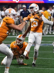 Tennessee holder Parker Henry, center, holds for kicker Aaron Medley (25) during the Chick-fil-A Kickoff Game against Georgia Tech on Sept. 4, 2017, in Atlanta.