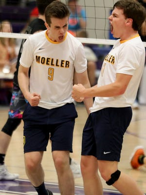 Moeller's Brayden Vaughan and  Ryan Devolve react during the Cruaders boys volleyball state semi-final Sunday, June 3. 2018.