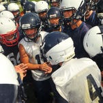 Eau Gallie High players get fired up before Tuesday practice held on the Eau Gallie High Football practice field .