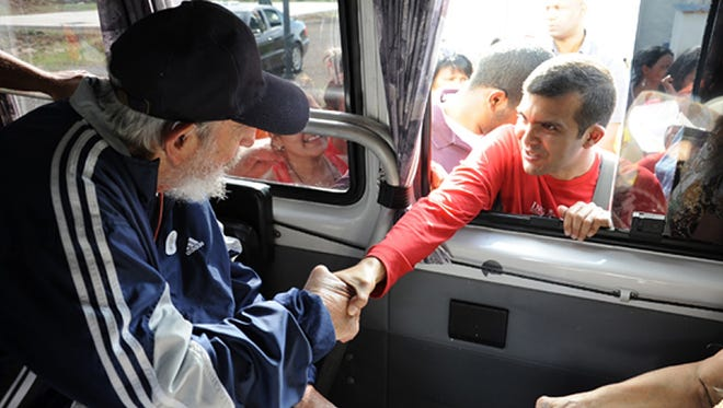 Handout picture released on April 3, 2015 by Cuban official website www.cubadebate.cu, showing former Cuban president Fidel Castro greeting a member of the Venezuelan delegation.