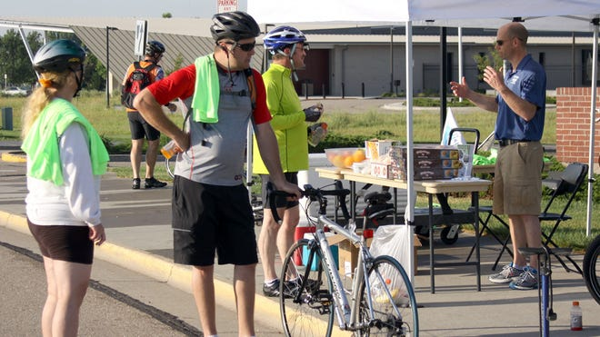 Lori Mayle and Shawn Logan stopped for a rest on the way to work Wednesday. Logan had already biked 15 miles around Windsor and had 14 more to go to work at Mail & Copy in Loveland. They participated in the annual Bike to Work Day.