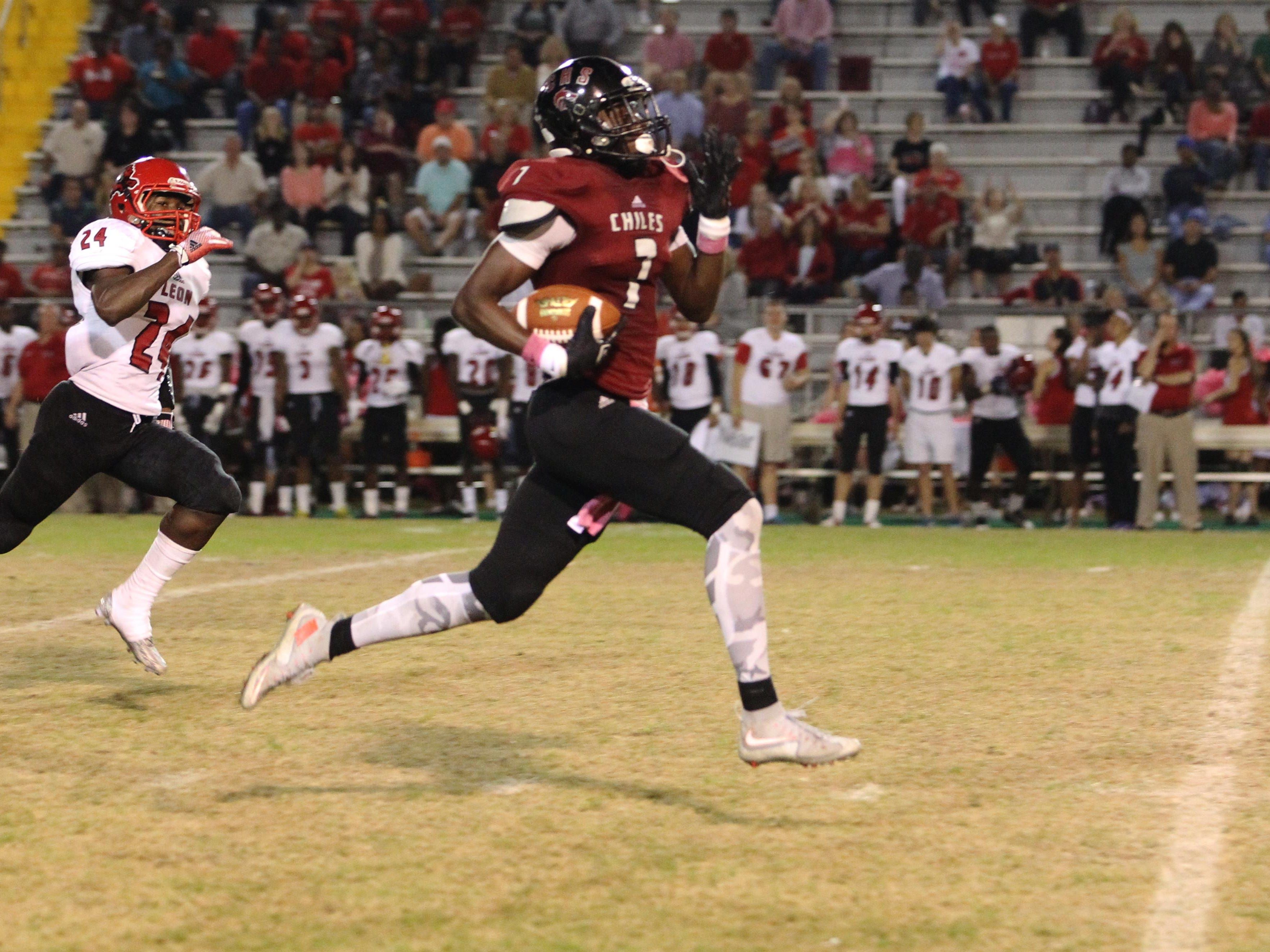 Chiles receiver John Mitchell sprints for an 80-yard touchdown as part of his 4-catch, 156-yard night, however, the Timberwolves were upended by Leon, 22-21, on a game-winning touchdown with 28 seconds left.