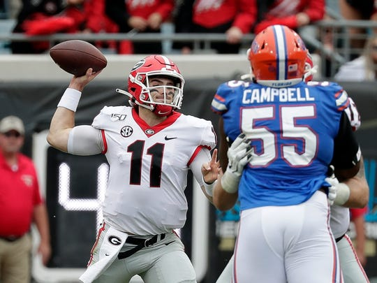 Georgia quarterback Jake Fromm (11) throws a pass over Florida defensive lineman Kyree Campbell (55) during Saturday's game.
