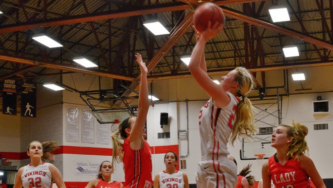Avery County's Heaven Nelson takes a shot during a NCHSAA 1-A playoff game on Feb. 23 in Newland.