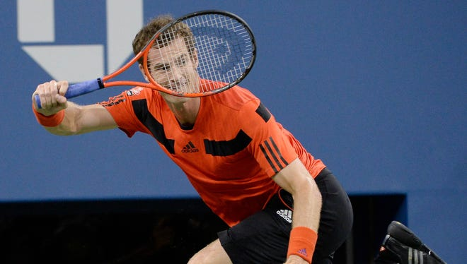 Andy Murray of Britain chases down a forehand during his opening-round match Wednesday against Michael Llodra  of France.
