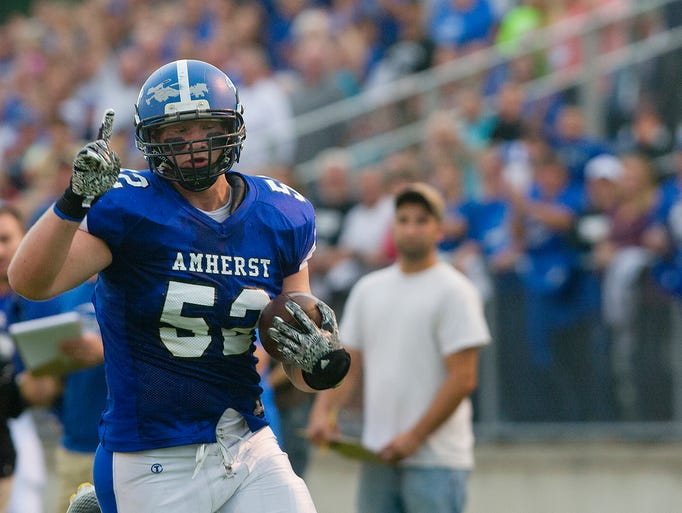 Amherst's Tyler Biadasz flashes the number 1 sign as