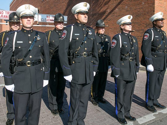 Members of the Murfreesboro Police Department and Rutherford County Sheriff Department Honor Guard wait to join other honor members in a march to the Historical Courthouse for the 9/11 Remembrance Ceremony.