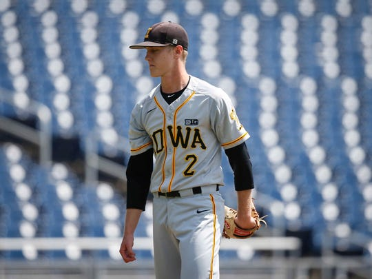 Iowa junior pitcher Zach Daniels heads off the mound between innings against Michigan during the Big 10 Baseball Tournament on Wednesday, May 23, 2018, in Omaha, Neb.