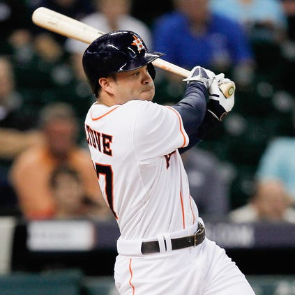 HOUSTON, TX - SEPTEMBER 15:  Jose Altuve #27 of the Houston Astros singles in the third inning against the Cleveland Indians at Minute Maid Park on September 15, 2014 in Houston, Texas.  (Photo by Bob Levey/Getty Images)
