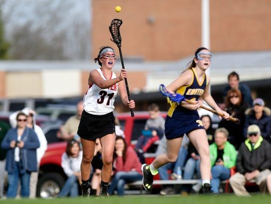 Dover's Sarah Kistner passes the ball in a girls lacrosse