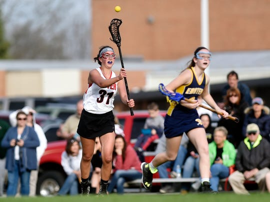 Dover's Sarah Kistner passes the ball in a girls lacrosse game against Eastern York Thursday, March 31, 2016, at Dover. Dover's girls lacrosse team is in its first season, after six years of planning, fundraising and team-building.