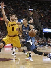 The Minnesota Timberwolves' Zach LaVine, right, drives past the Cleveland Cavaliers' Matthew Dellavedova, from Australia, in the second half Monday in Cleveland.