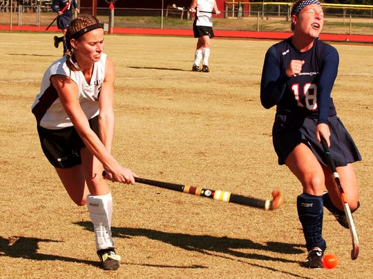 Salisbury's Brittany Elliott (left) in action in a