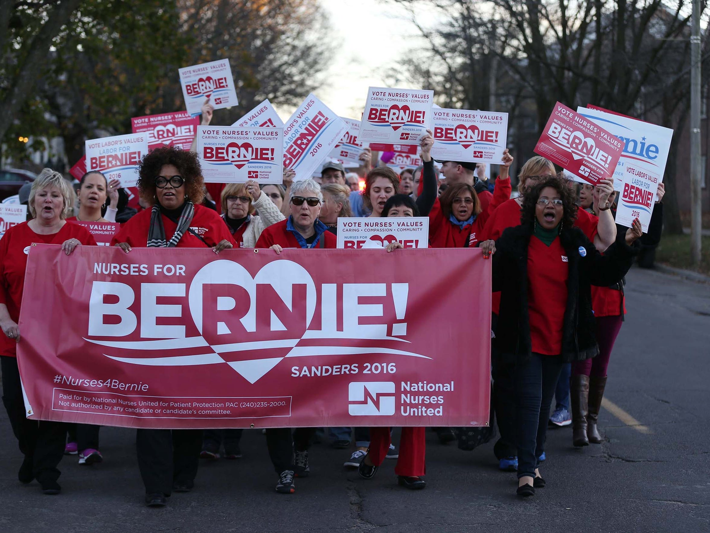 A group of registered nurses rally for Bernie Sanders ahead of the Democratic Debate on Saturday, Nov. 14, 2015, in Des Moines. The group of nurses and other supporters marched from Drake Park to another Sanders event near the Drake University campus.