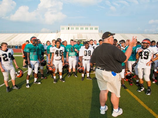 Former Central York head football coach Brad Livingston addresses his players in 2012.