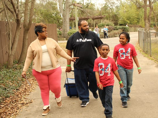 The Timmons family, from left: Yolanda, Leslie, Emanuel and Jeremiah, right, enjoyed Animal Enrichment Day at the Montgomery Zoo Saturday. (Alvin Benn/Special to the Advertiser)