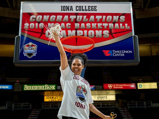 Iona women's basketball coach Billi Chambers (Godsey) cuts down the net after her team's MAAC tournament championship at the Times Union Center in Albany on March 7, 2016.