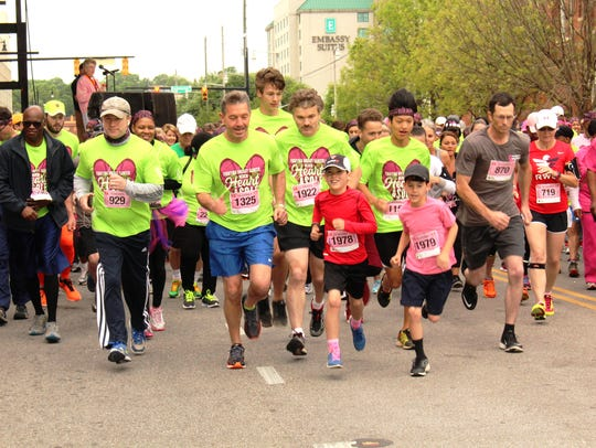 Competitors in the Walk of Life 5k race leave the starting