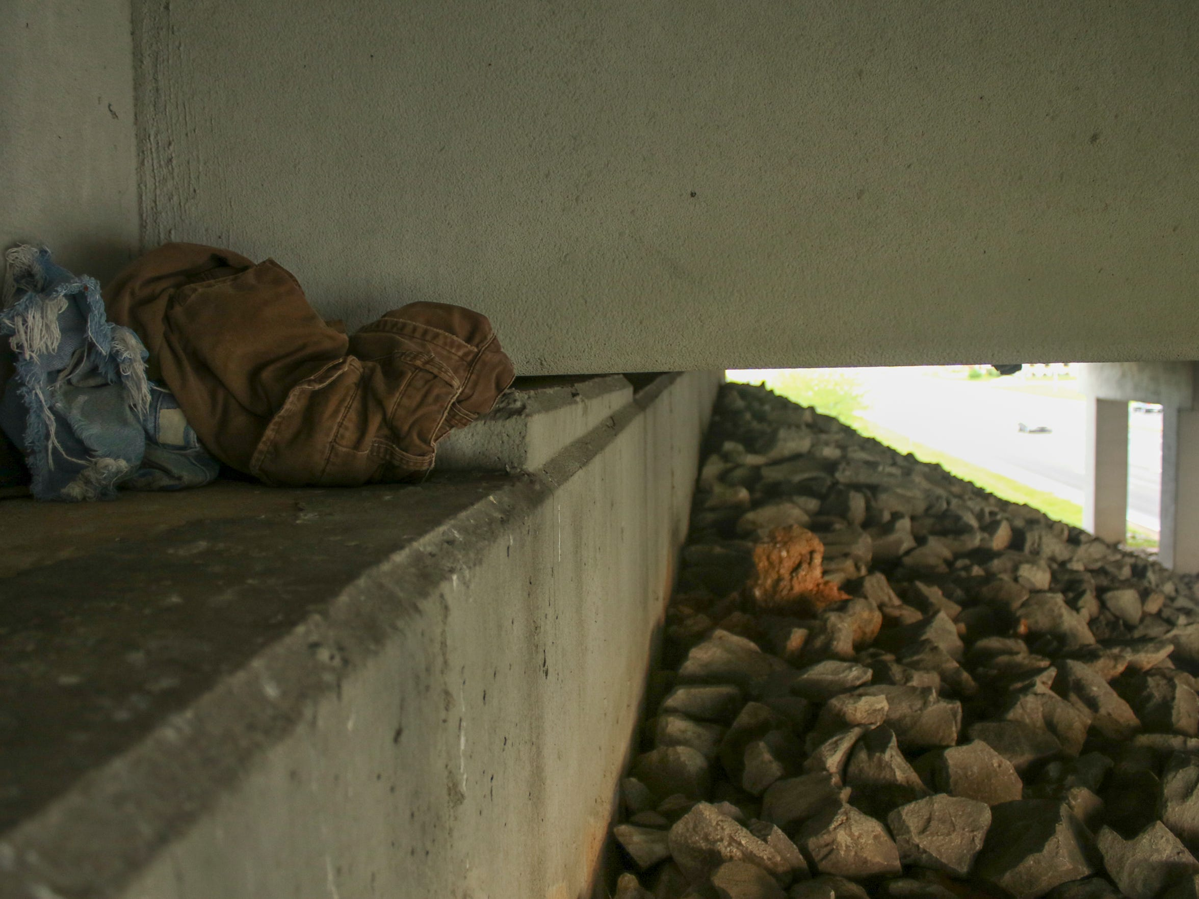 Clothes sit under the 101st Airborn Division Parkway overpass above Fort Campbell Boulevard. This overpass is frequently cited as a spot for the homeless to rest while panhandling.