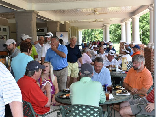 Players enjoyed lunch on the veranda of the Robert