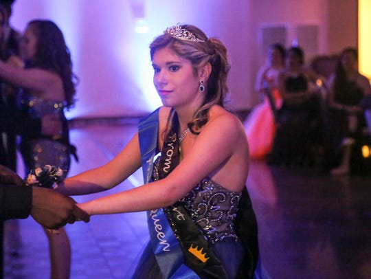 Peyton Smith dances with the prom king, Nick Fuches,