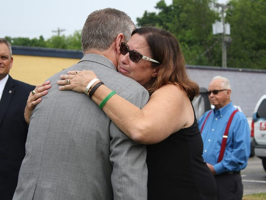 Tyler Head's mother Gina Head-Heiber hugs State Rep.